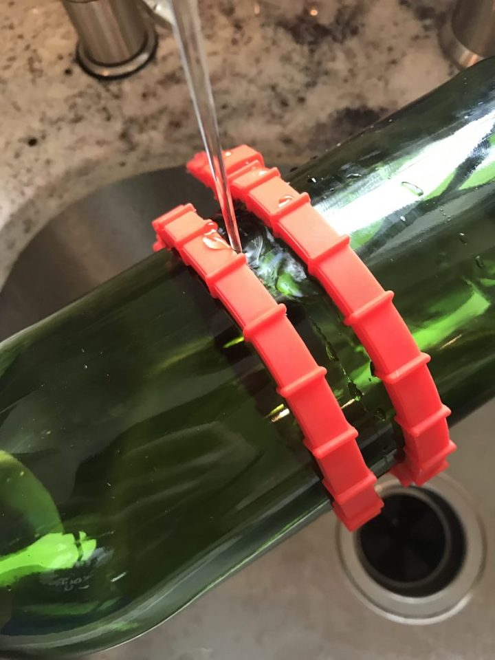 pouring hot water to cut wine bottle for candle