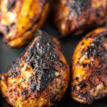 grilled BBQ chicken on baking sheet