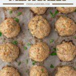 overhead shot of baked turkey meatballs on baking sheet