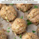 turkey meatballs lined up on baking sheet