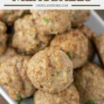 baked turkey meatballs stacked on white plate