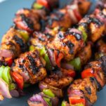 stacked BBQ chicken kebabs on plate
