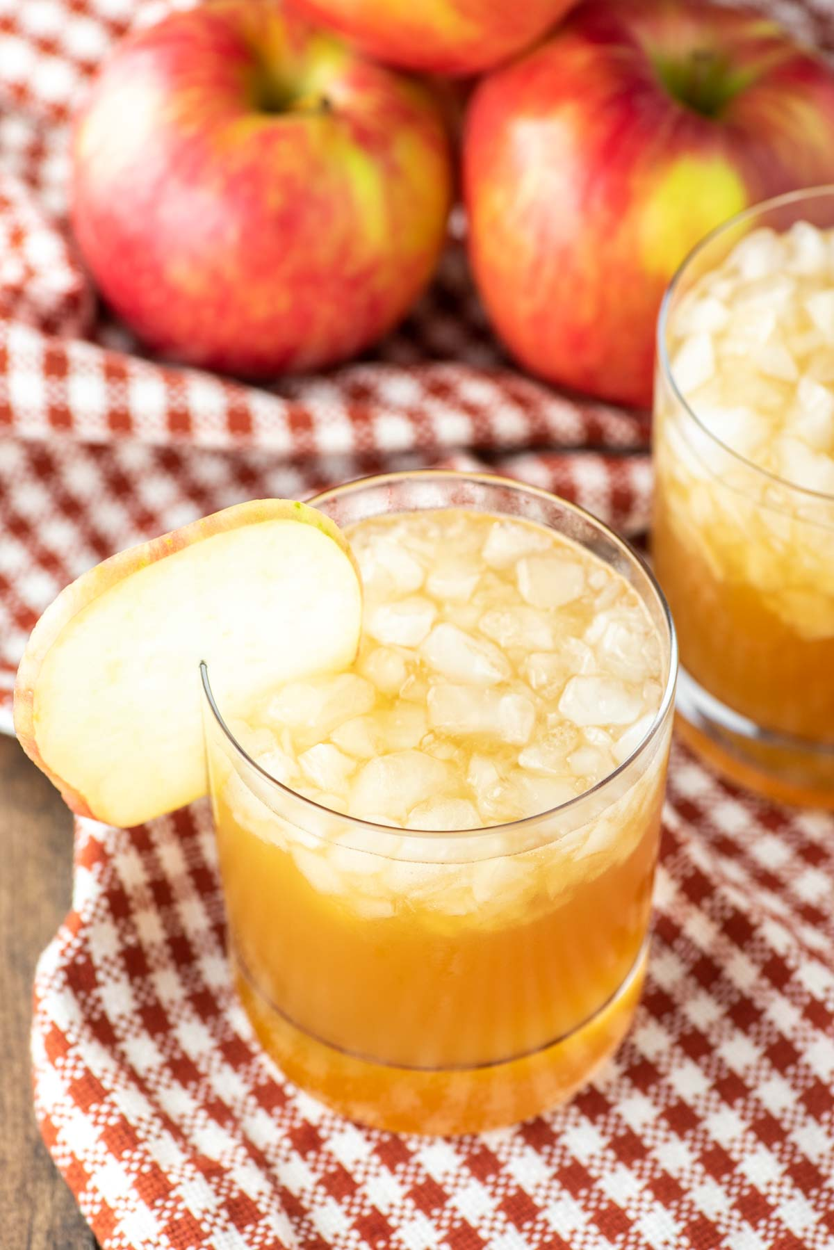 apple cider cocktail in glass on dish towel