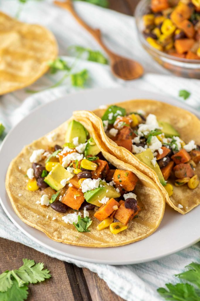 two sweet potato tacos on plate
