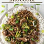 overhead shot of beef and broccoli with chopsticks on plate