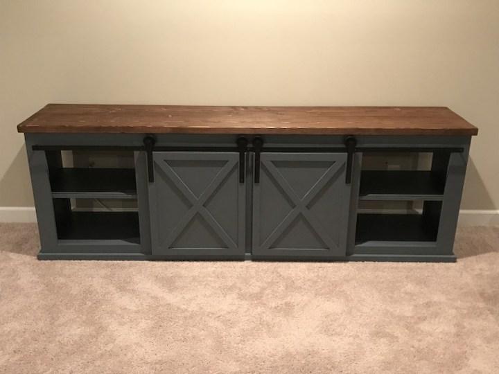 add sliding doors to entertainment center