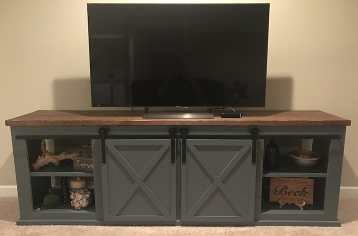 tv on top of sliding door entertainment center