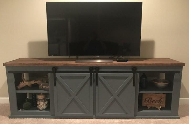 tv on top of sliding door entertainment center