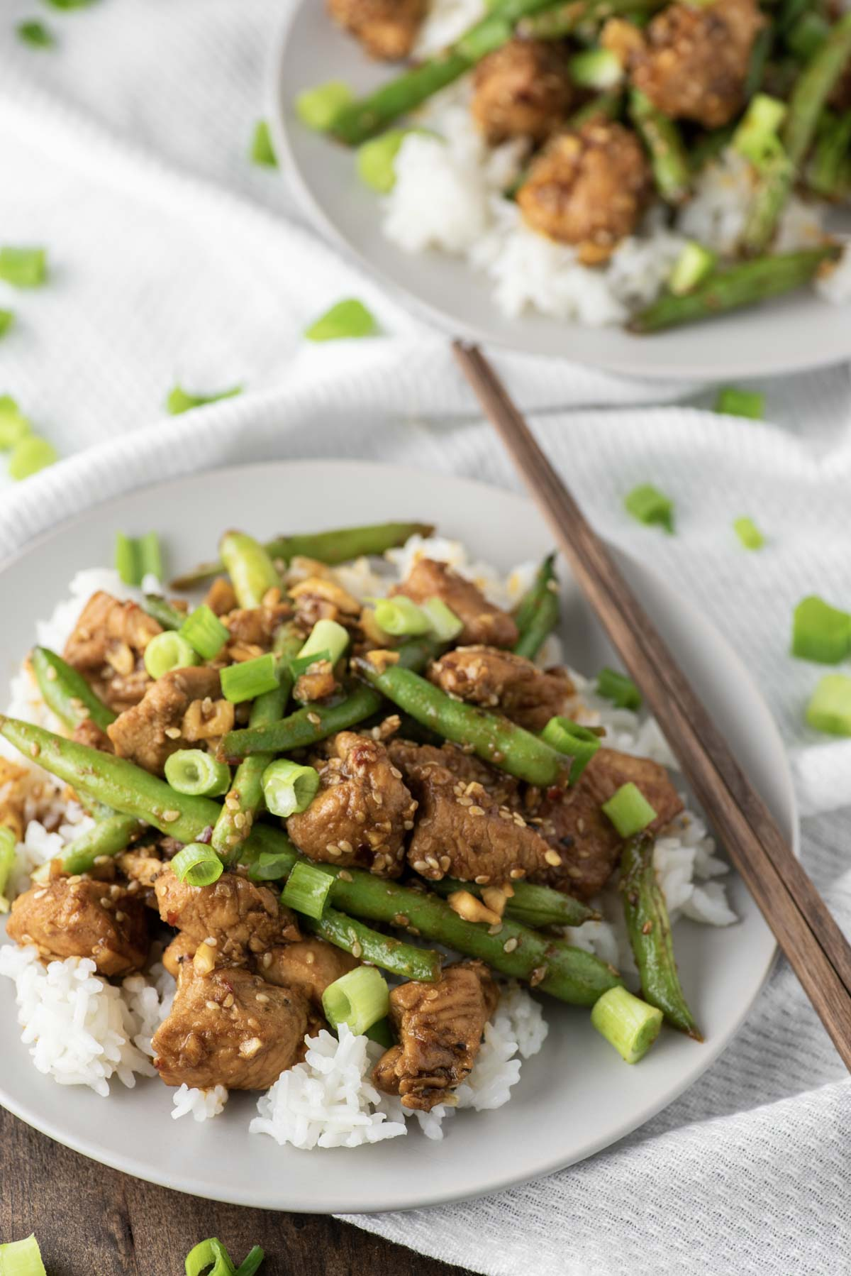 chicken and green bean stir fry on two plates