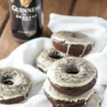 close-up of Guinness chocolate donuts stacked on white kitchen towel