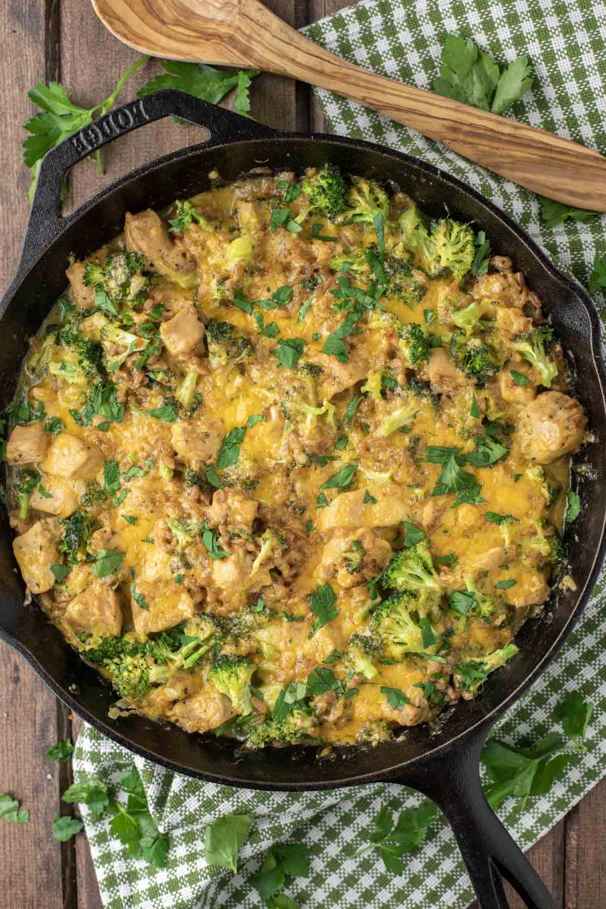 overhead shot of chicken and broccoli bake in cast iron skillet