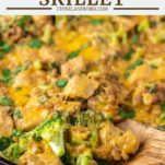 spoon dipped in chicken broccoli skillet
