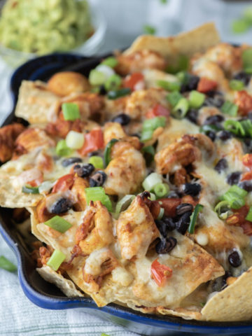 chicken nachos in cast iron skillet