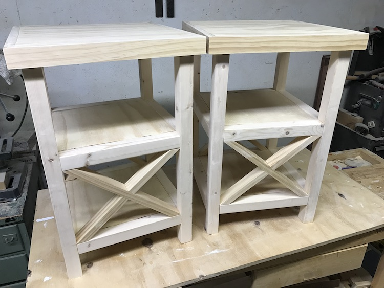 two finished x end tables