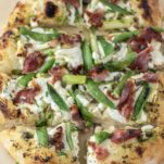 spring pizza sliced on parchment paper
