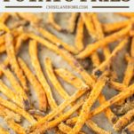 sweet potato fries on parchment-lined baking sheet