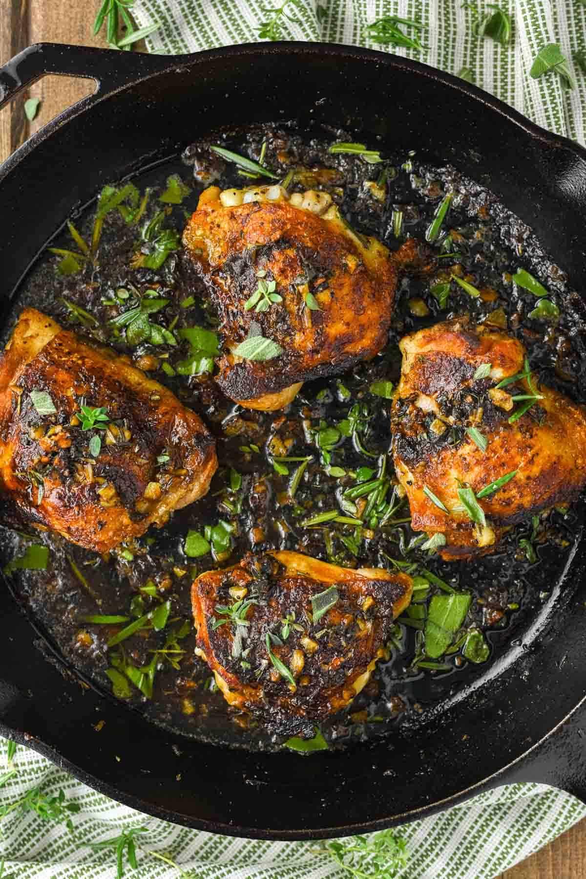 overhead shot of garlic herb chicken in skillet