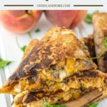 stacked BBQ chicken and peach quesadillas on wood board