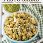 chickpeas with pesto in blue bowl with dish towel