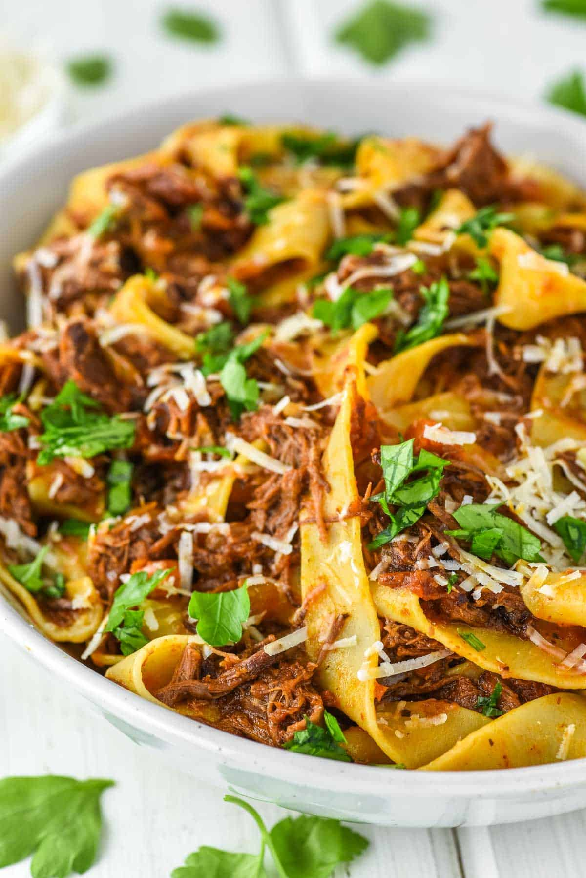 close-up of short rib ragu with pasta in bowl