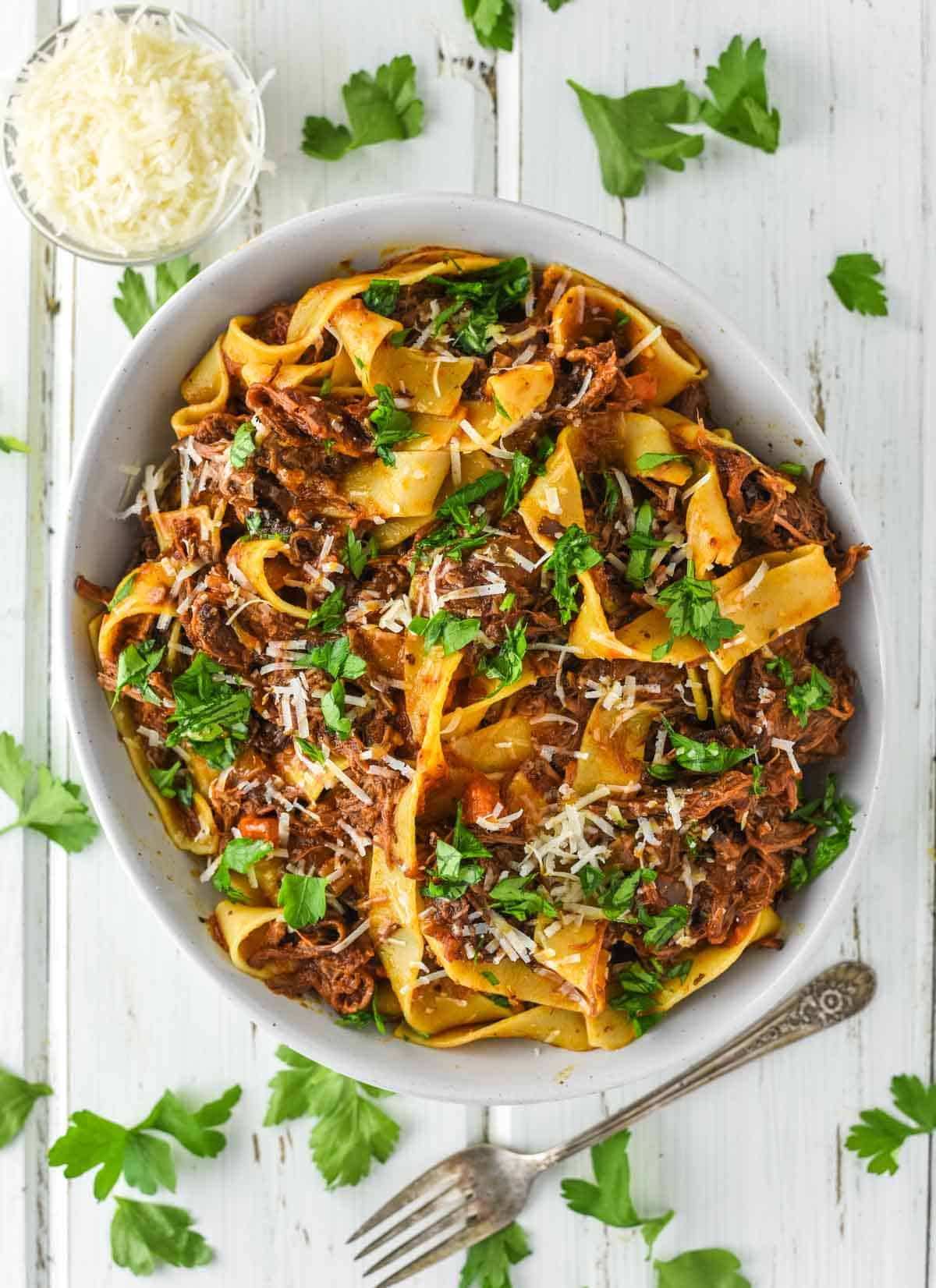 overhead shot of ragu with short ribs and pasta in bowl