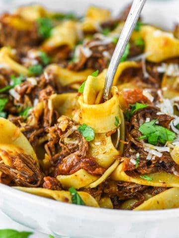 fork twirling pasta in bowl