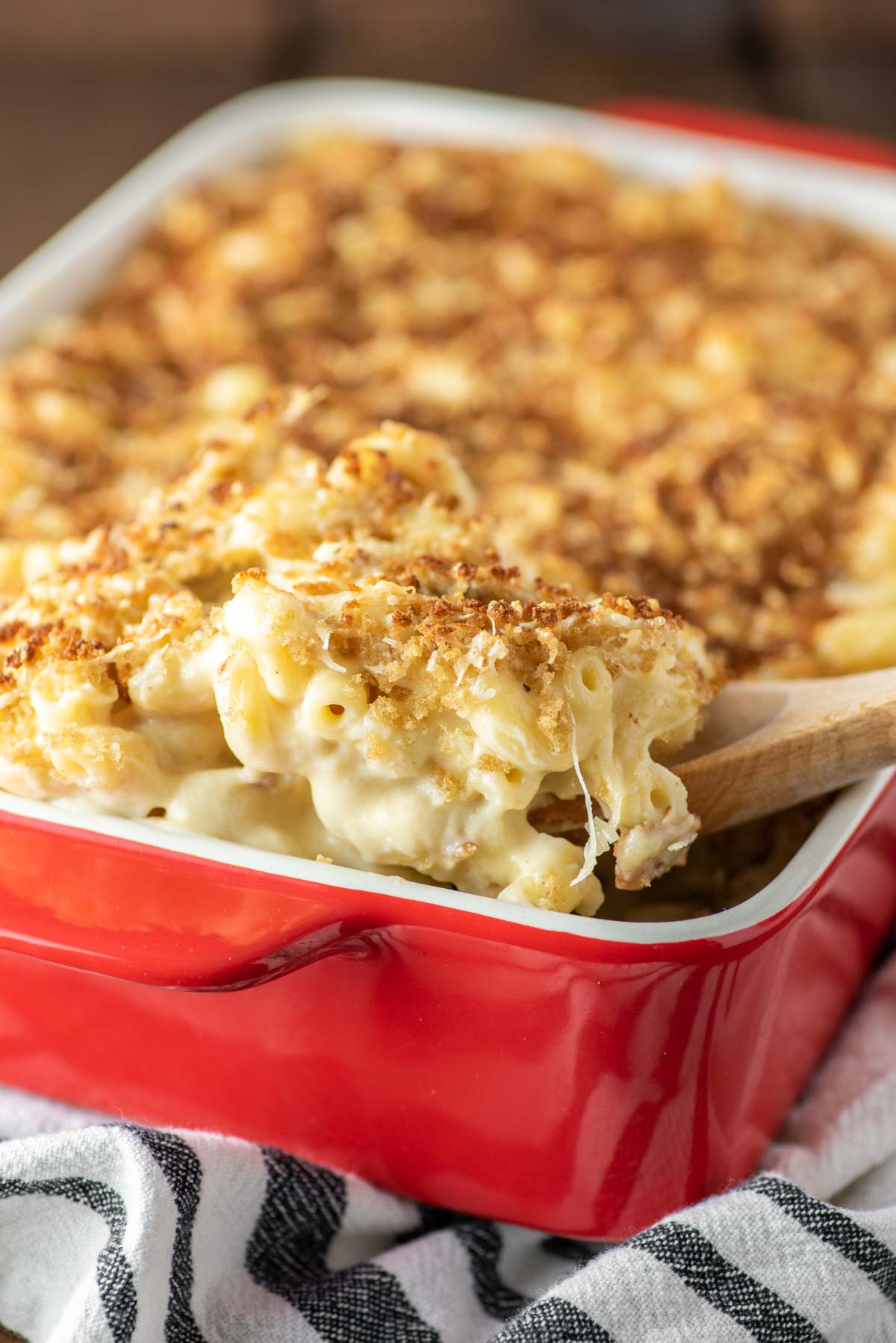 baked gouda mac and cheese in oval green baking dish