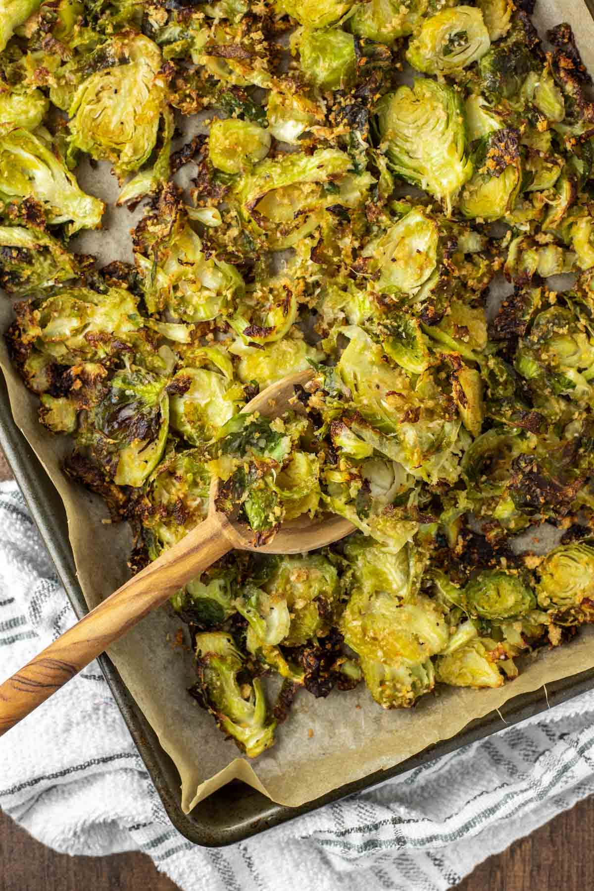 overhead shot of spoon dipped in pan of roasted Brussel sprouts