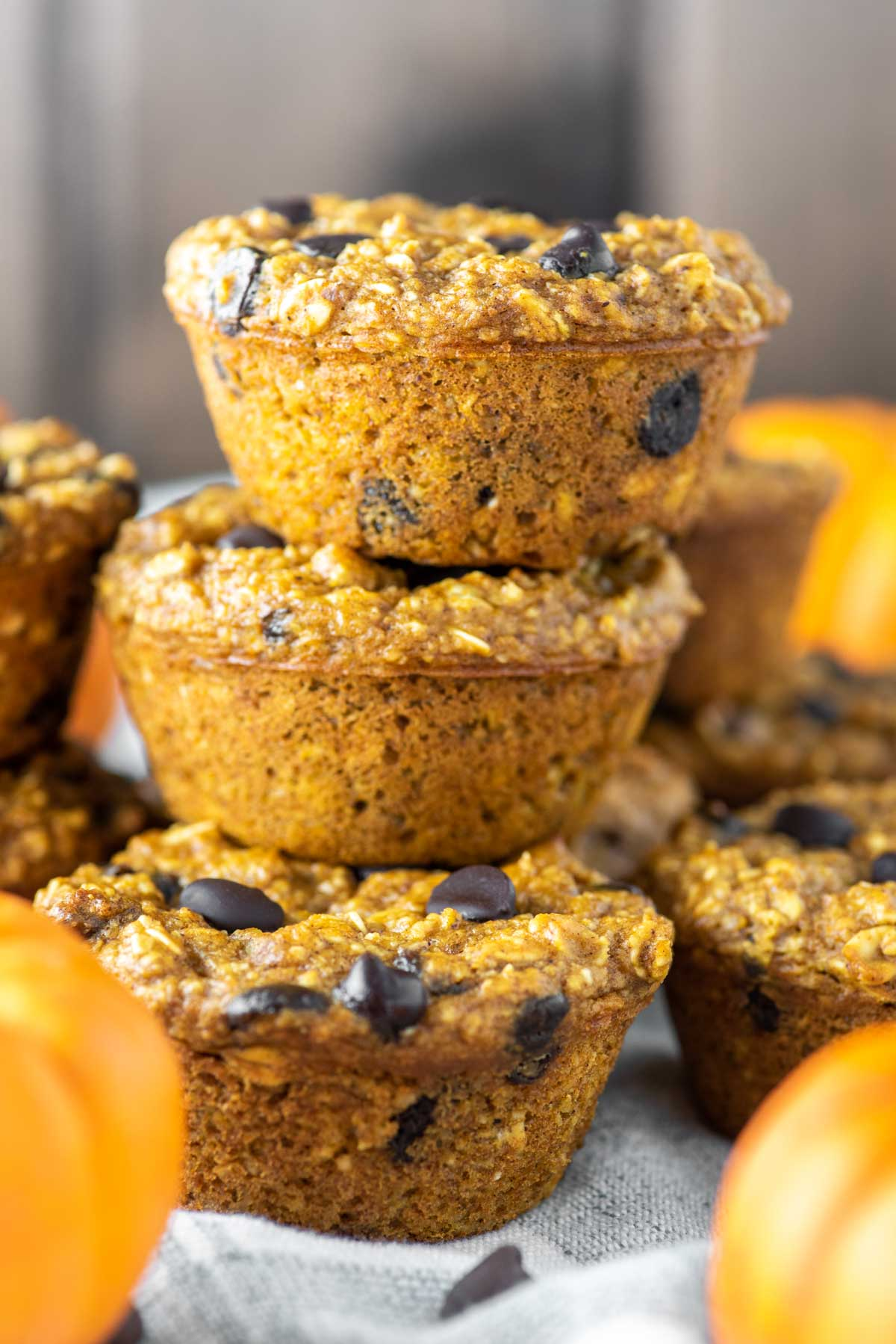 three stacked pumpkin oatmeal muffins