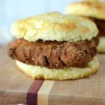 close-up of copycat Chick-fil-A chicken biscuit on wood cutting board