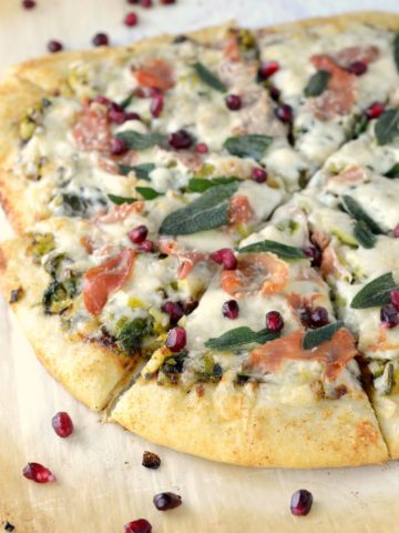 close-up of charred Brussels sprouts pizza on parchment paper