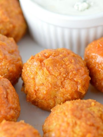 close-up of buffalo quinoa bites on white plate