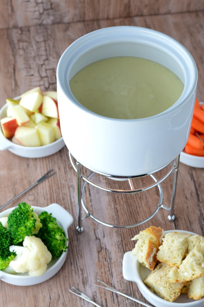 fondue in white pot with dippers