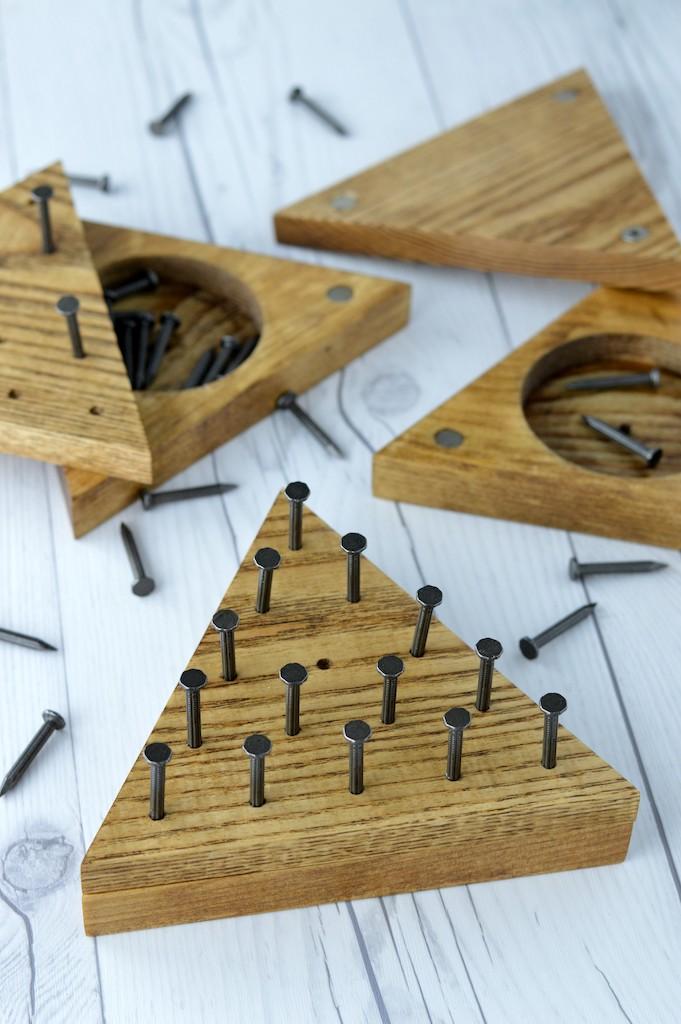 close-up of DIY triangle peg game