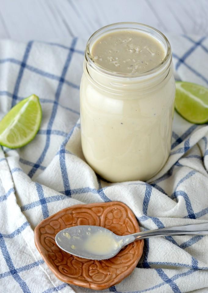 close-up of lime caesar dressing in mason jar