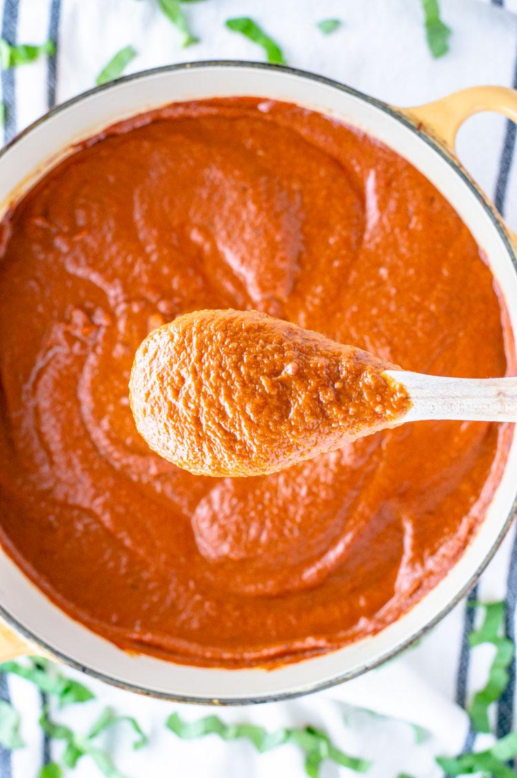overhead shot of spoon of brown butter marinara sauce