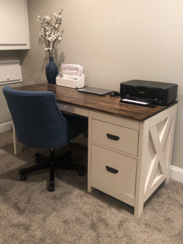 farmhouse desk in office with blue chair