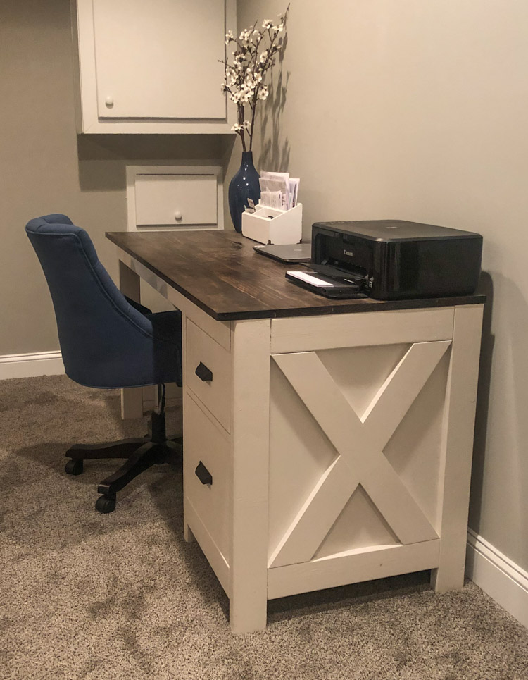 side view of farmhouse desk in office with blue chair