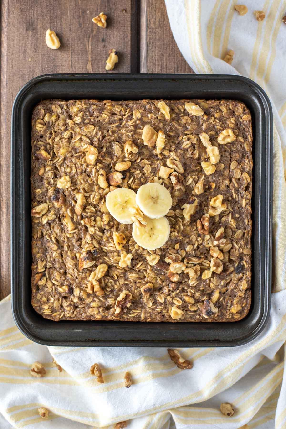 overhead shot of banana baked oatmeal in square baking pan
