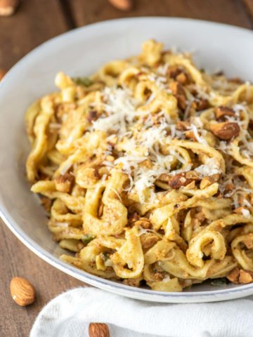 almond pesto fettuccine in white bowl