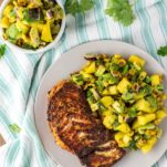 overhead shot of blackened cod with corn mango salsa on plate