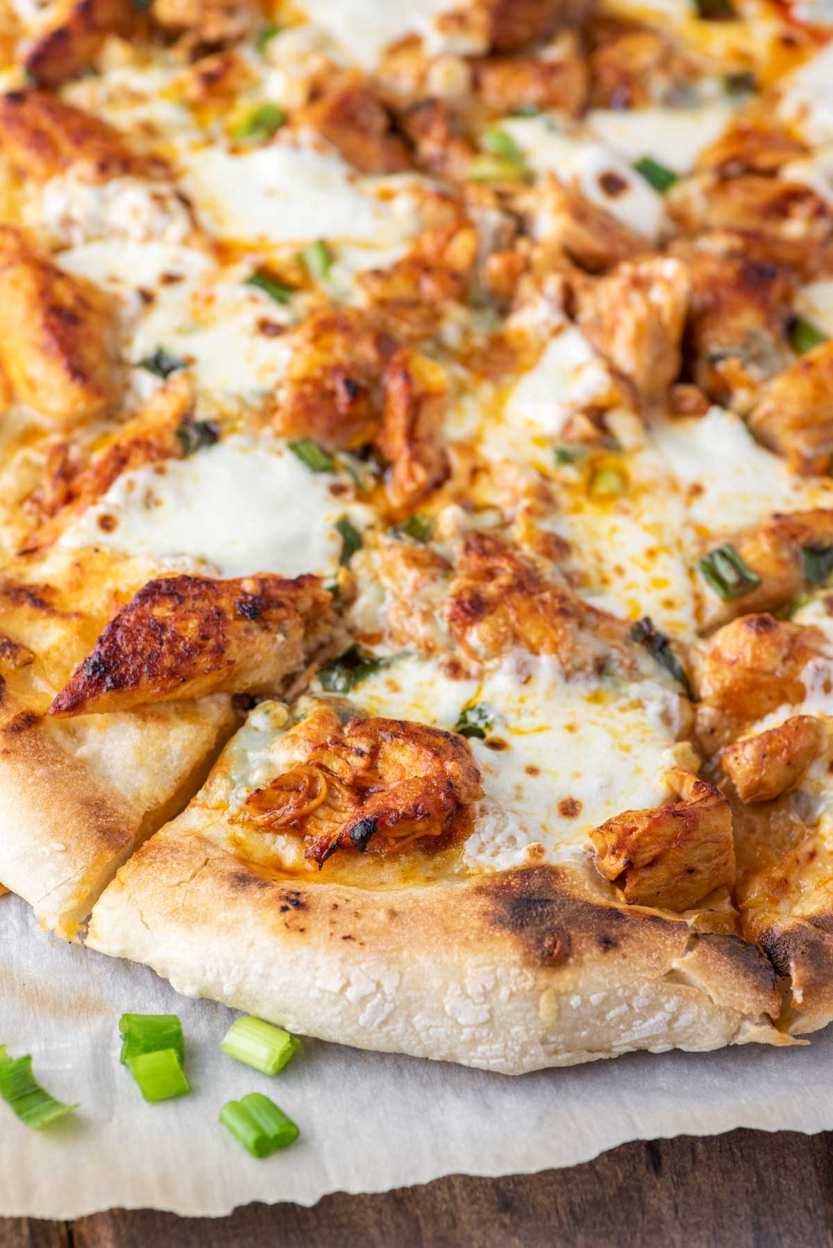 buffalo chicken pizza on parchment paper