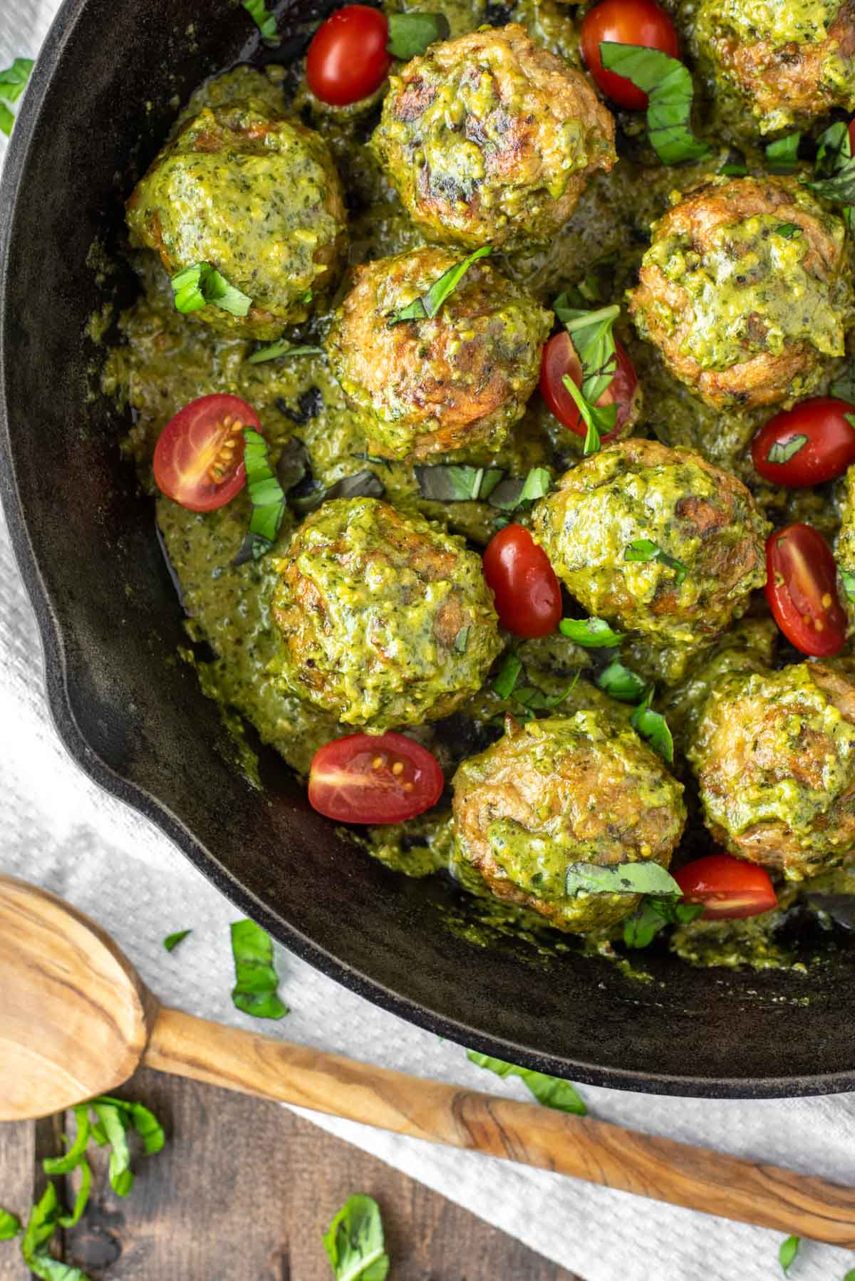 overhead shot of pesto meatballs in skillet