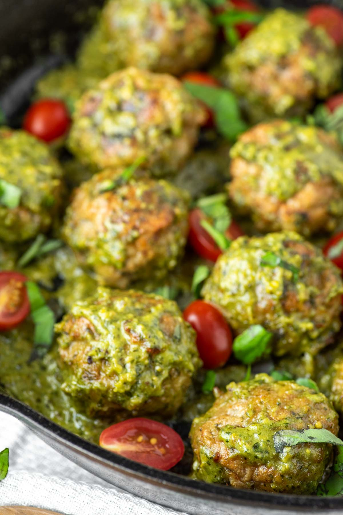 pesto meatballs in cast iron skillet
