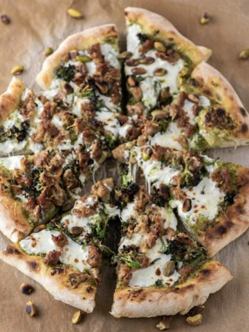 slices of broccoli rabe pizza on parchment paper