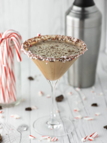 chocolate peppermint martini in glass with cocktail shaker in background