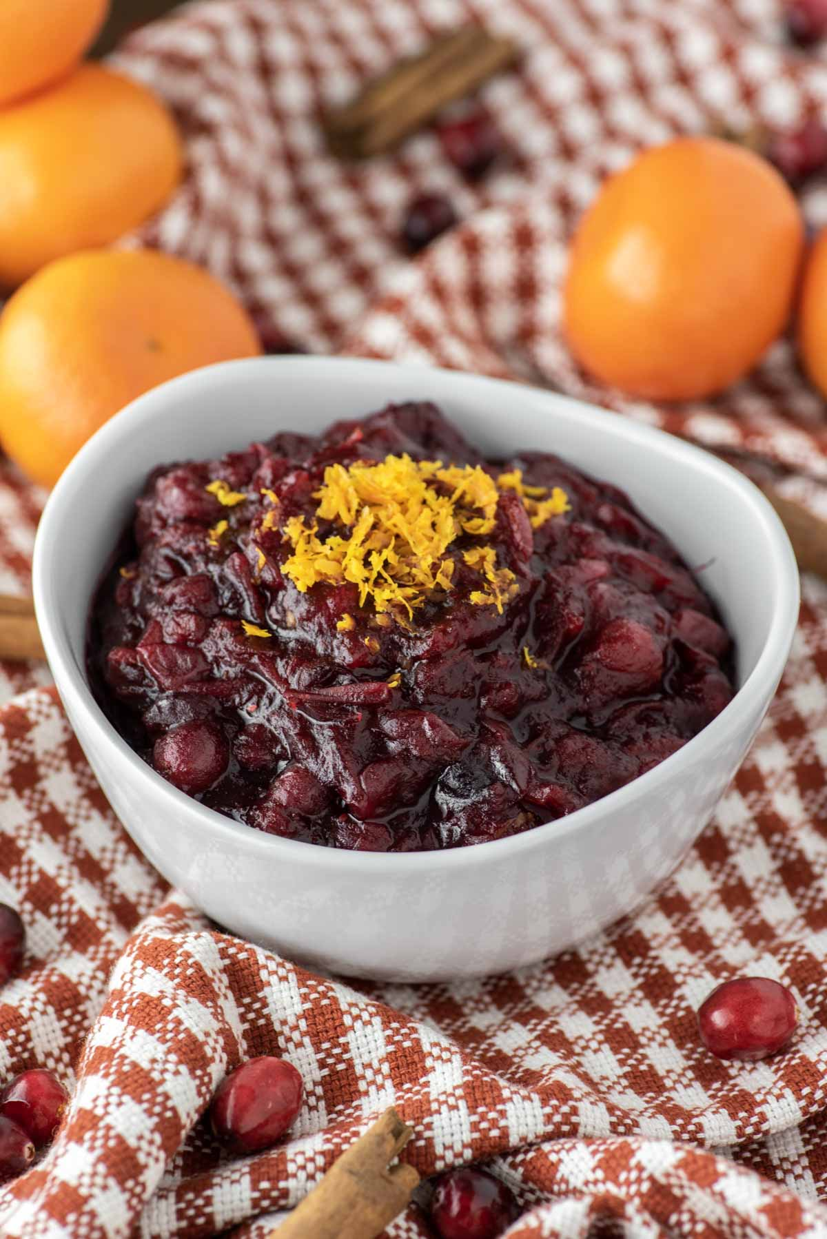 cranberry sauce in white bowl on dish towel