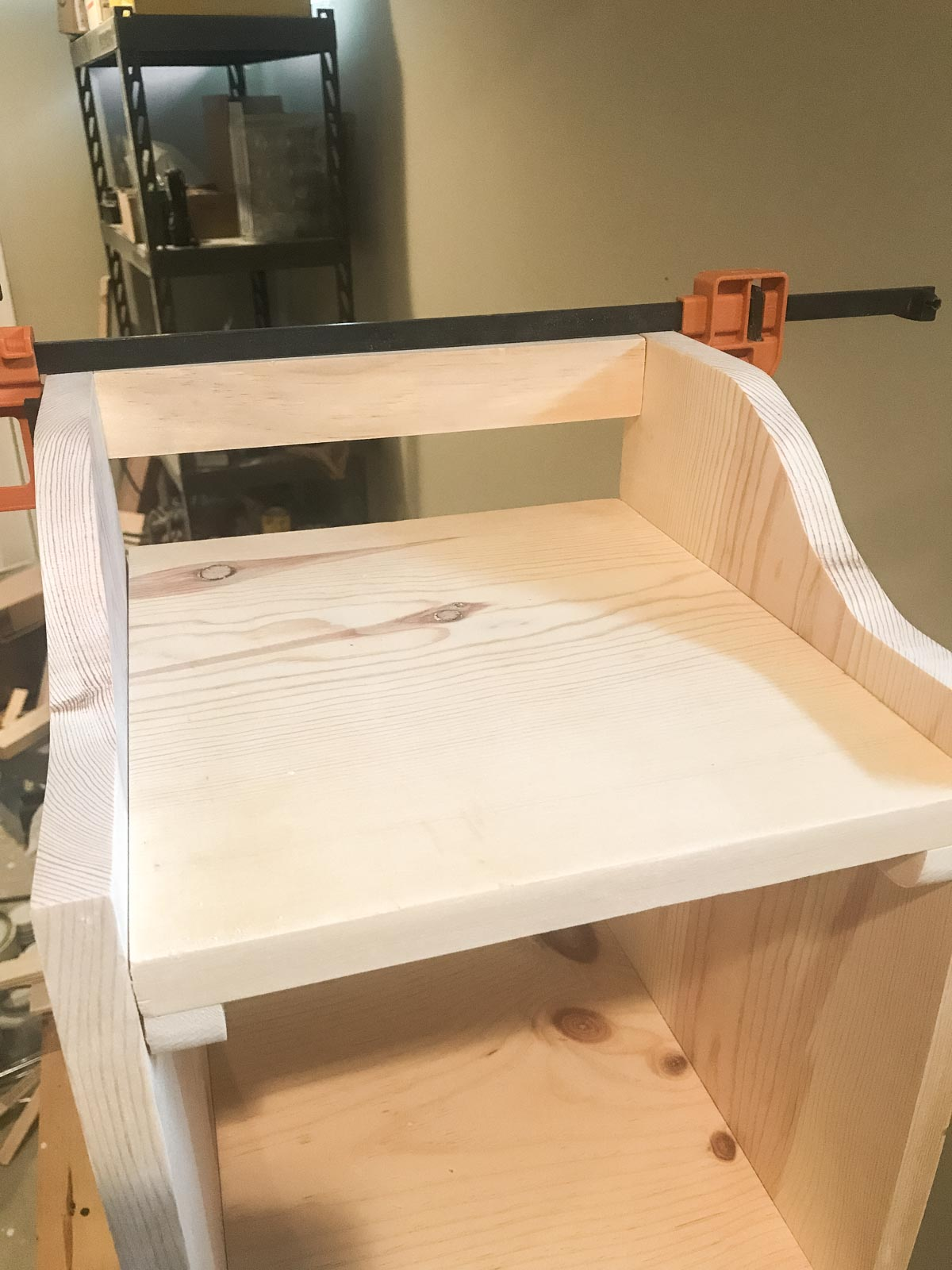 clamping back side rail to bookshelf