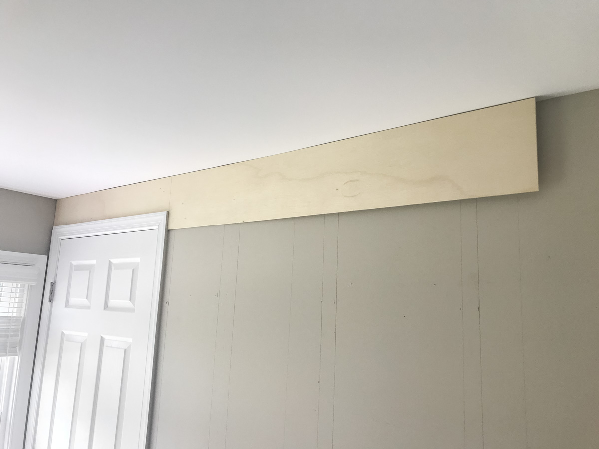 nailing top plank on wall