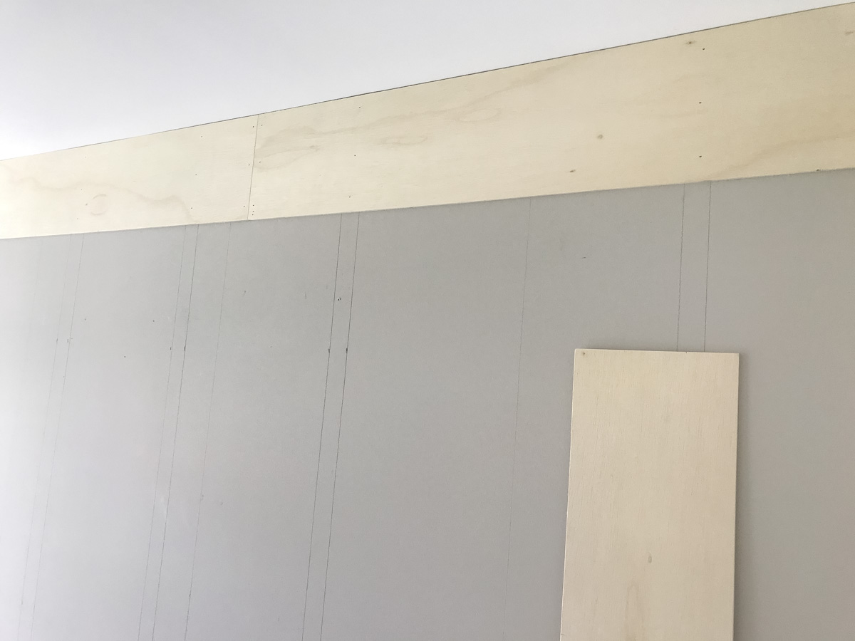 finishing top plank by nailing on wall